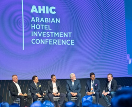 Arabian Hotel Investment Conference speakers on stage