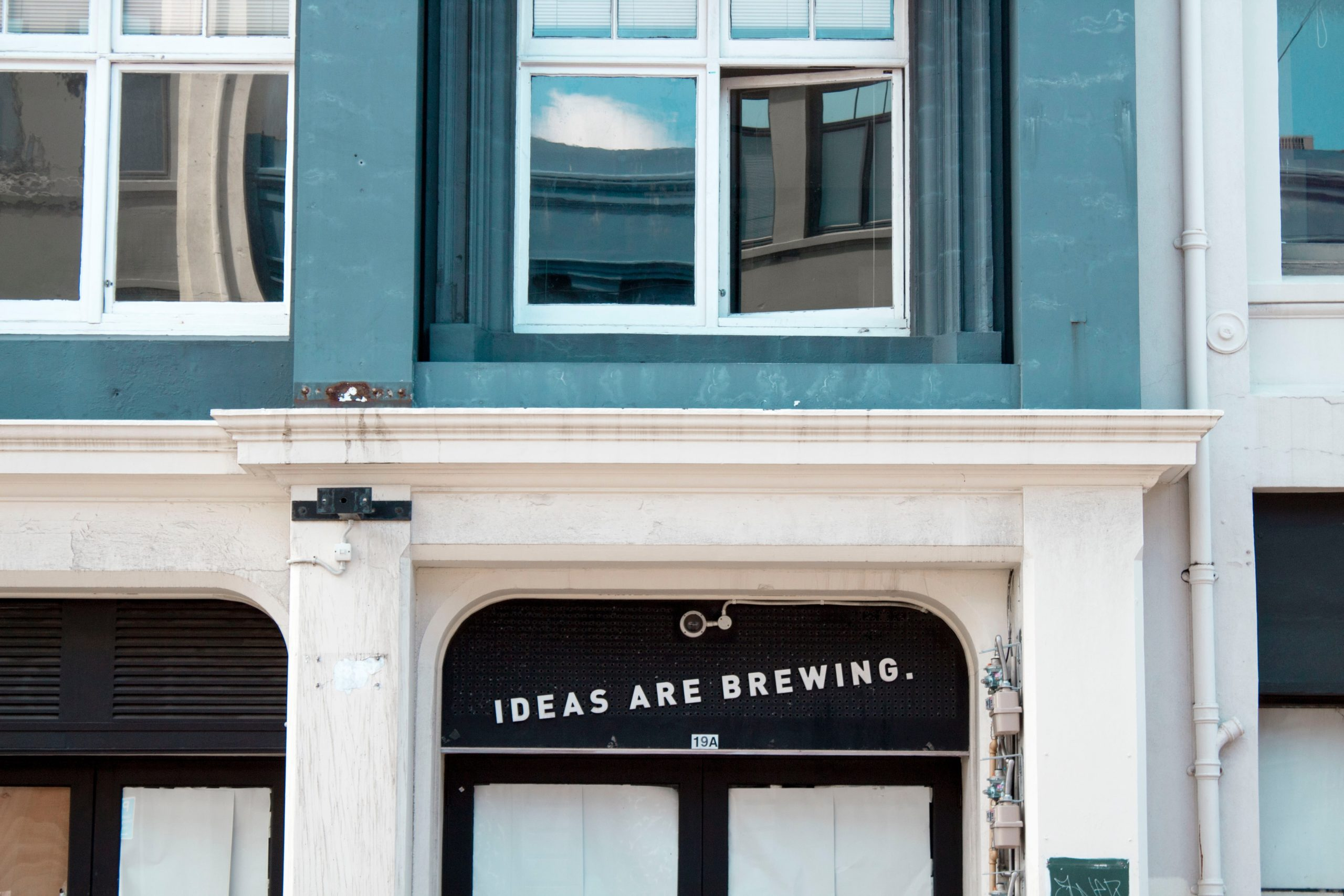 Front door with saying Ideas Are Brewing