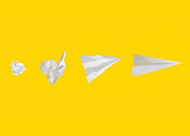 crumpled paper to paper airplane in yellow background